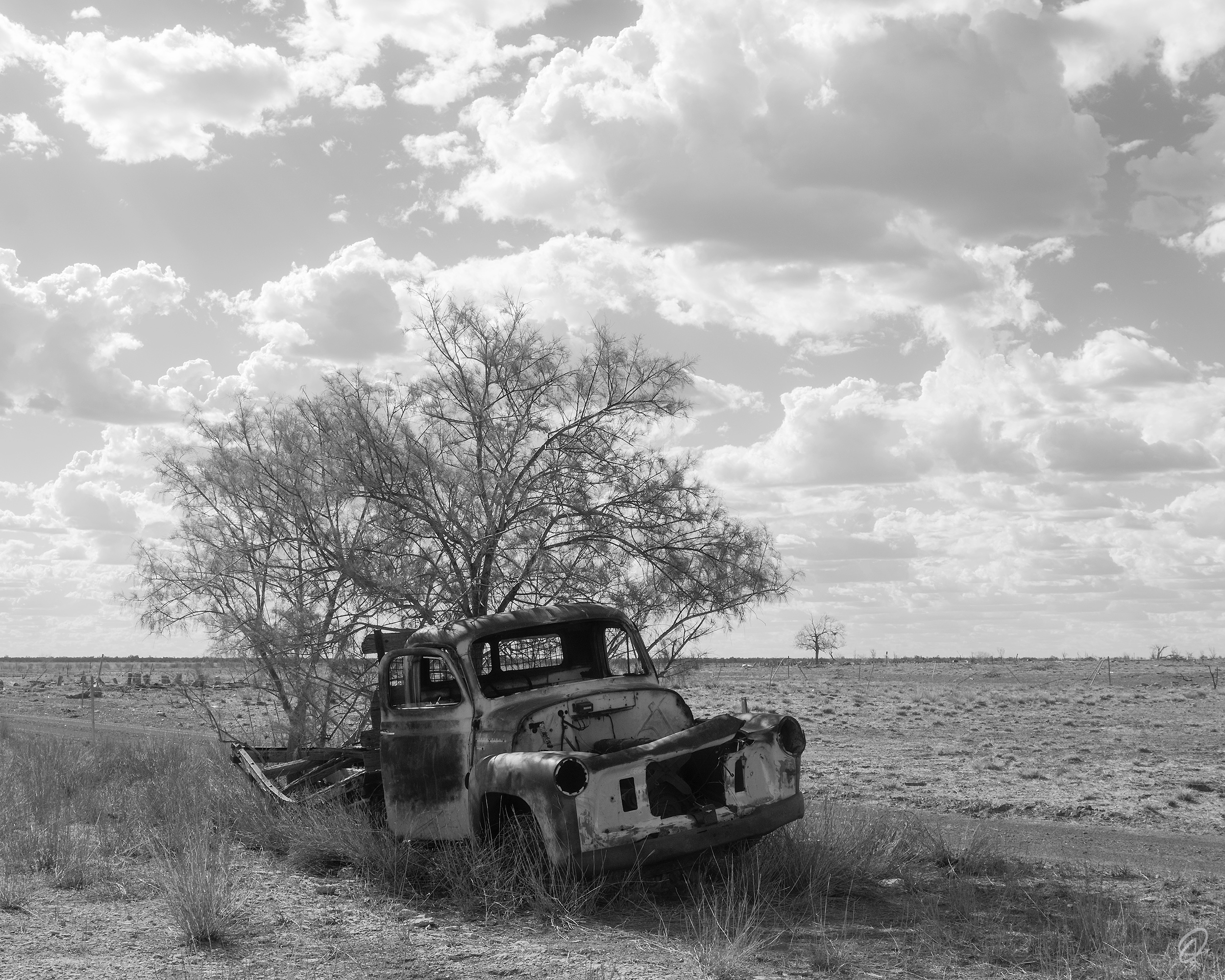 A rusty vintage car in the Australian outback