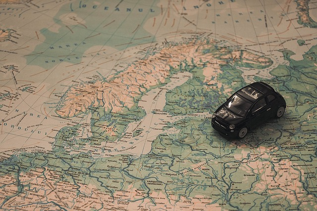 A car on a map of the world