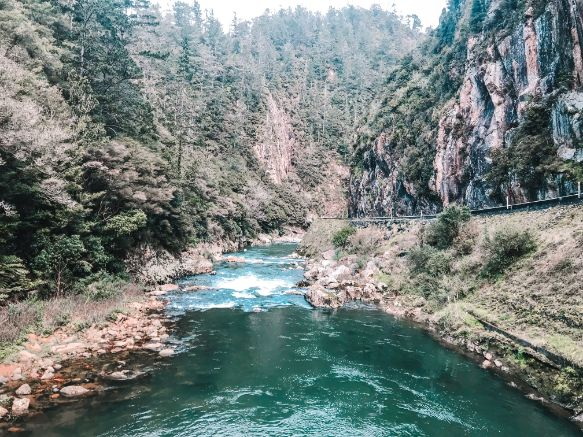Unique places to visit on New Zealand's North Island include these waters of Karangahake Gorge as they rush through the valley