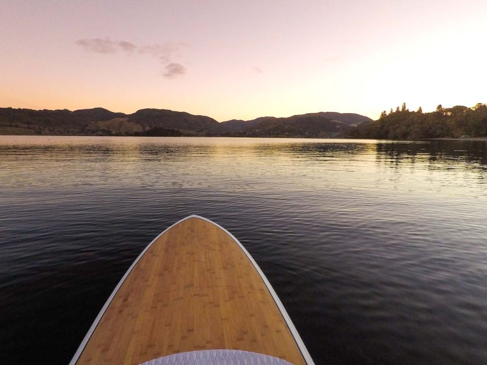 Unique places to visit on New Zealand's North Island include SUP near rotorua